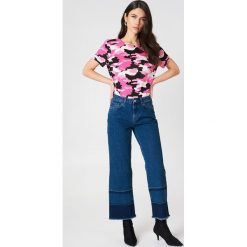NA-KD T-shirt moro z dekoltem na plecach - Pink. Różowe t-shirty damskie NA-KD, moro, z bawełny, z dekoltem na plecach. W wyprzedaży za 24,29 zł.