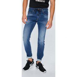 Diesel - Jeansy Thommer. Niebieskie jeansy męskie z dziurami Diesel. W wyprzedaży za 799,90 zł.
