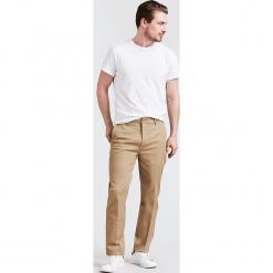 """Spodnie chino """"502®"""" - Regular fit - w kolorze beżowym. Brązowe chinosy męskie Levi's®, w paski. W wyprzedaży za 173,95 zł."""