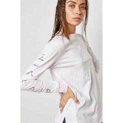 Essential T-Shirt 932482-682. Różowe t-shirty damskie Nike. Za 159,99 zł.