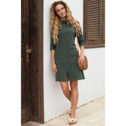 VIDA Sukienka oversize z dużymi kieszeniami i rozcięciem na dole - militarno zielona. Zielone sukienki Moe, do pracy, s, z dresówki, biznesowe, oversize. Za 129,99 zł.
