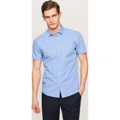 Koszula z mikroprintem slim fit - Niebieski. Niebieskie koszule męskie slim marki Reserved, l. Za 69,99 zł.