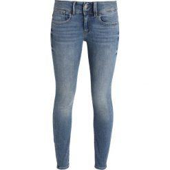 GStar LYNN MID SKINNY ANKLE Jeans Skinny Fit medium indigo aged. Niebieskie rurki damskie G-Star, z bawełny. Za 559,00 zł.