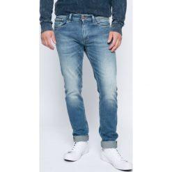 Calvin Klein Jeans - Jeansy. Niebieskie jeansy męskie slim marki Calvin Klein Jeans, z aplikacjami, z bawełny. W wyprzedaży za 439,90 zł.