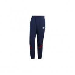 Spodnie treningowe adidas  Spodnie dresowe Sportive. Niebieskie spodnie dresowe męskie Adidas, z dresówki. Za 329,00 zł.
