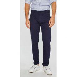 Tommy Jeans - Spodnie. Szare chinosy męskie Tommy Jeans, z bawełny. Za 359,90 zł.