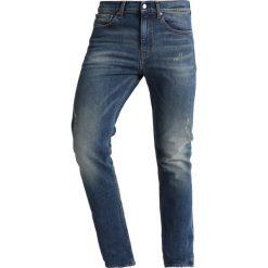 Calvin Klein Jeans 016 SKINNY Jeans Skinny Fit blue denim. Niebieskie rurki męskie Calvin Klein Jeans, z bawełny. Za 589,00 zł.
