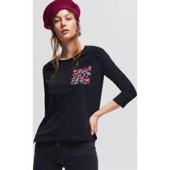 T-shirt z nadrukiem - Czarny. Czarne t-shirty damskie marki Reserved, l, z nadrukiem. W wyprzedaży za 19,99 zł.