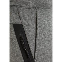 Nike Performance TECH PANT Spodnie treningowe carbon heather/anthracite. Szare spodnie chłopięce marki Nike Performance, z bawełny. W wyprzedaży za 254,15 zł.