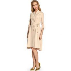 Sukienka na zakładkę s099. Brązowe sukienki asymetryczne Style, do pracy, s, biznesowe, z asymetrycznym kołnierzem. W wyprzedaży za 109,00 zł.