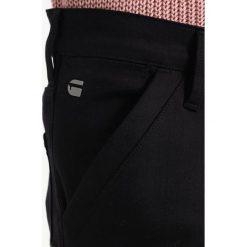 GStar RACKAM SUPER SLIM  Jeans Skinny Fit black superstretch. Czerwone jeansy męskie relaxed fit marki G-Star, l, z napisami. W wyprzedaży za 494,25 zł.