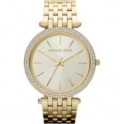 """Zegarek kwarcowy """"Darci Glitz"""" w kolorze złotym. Żółte, analogowe zegarki damskie marki Michael Kors, ze stali. W wyprzedaży za 627,95 zł."""