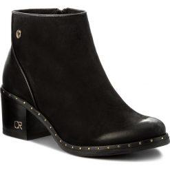 Botki CARINII - B4073 360-E50-POL-861. Czarne buty zimowe damskie Carinii, z nubiku. W wyprzedaży za 239,00 zł.