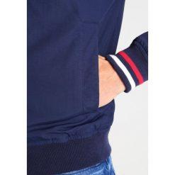 Tommy Jeans Kurtka wiosenna blue. Niebieskie kurtki męskie jeansowe Tommy Jeans, m. Za 549,00 zł.