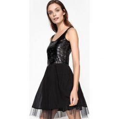 Sukienki hiszpanki: Sukienka rozkloszowana, góra z cekinami, dół z tiulem halkowym