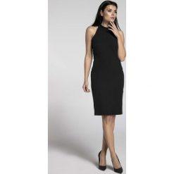 Czarna Stylowa Sukienka Bodycon z Półgolfem. Czarne sukienki balowe marki Molly.pl, do pracy, l, w kolorowe wzory, bodycon. W wyprzedaży za 116,16 zł.