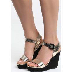 Złote Sandały Golden News. Białe sandały damskie marki Reserved, na wysokim obcasie. Za 109,99 zł.