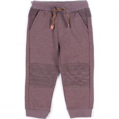 Spodnie. Brązowe spodnie chłopięce marki SCENT, z bawełny. Za 29,90 zł.