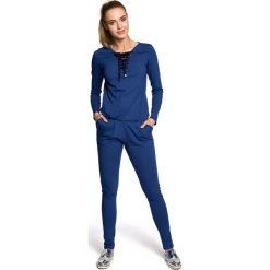 SARAH Kombinezon wiskoza - jeansowy. Niebieskie kombinezony damskie Moe, z jeansu. Za 159,90 zł.