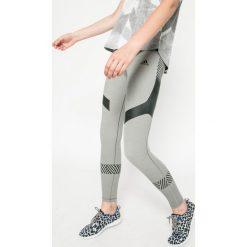 Adidas Performance - Legginsy Ultimate Tights Core Heather. Czerwone legginsy marki adidas Performance, m. W wyprzedaży za 159,90 zł.