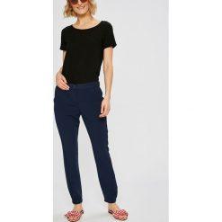 Tommy Jeans - Spodnie. Szare jeansy damskie rurki marki Tommy Jeans. W wyprzedaży za 319,90 zł.