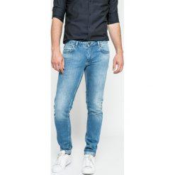 Marciano Guess - Jeansy Tommy. Niebieskie jeansy męskie regular MARCIANO GUESS. W wyprzedaży za 379,90 zł.