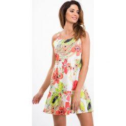 Kremowa sukienka w kwiaty / koral 21624. Białe sukienki Fasardi, l, w kwiaty. Za 69,00 zł.
