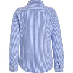 Polo Ralph Lauren STRIPE Koszula harbor island blue/white. Niebieskie bluzki dziewczęce bawełniane marki Adidas, z kontrastowym kołnierzykiem, z krótkim rękawem. W wyprzedaży za 255,20 zł.