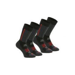 Skarpety turystyczne SH520 WARM MID. Czarne skarpetki męskie marki DOMYOS, z elastanu. Za 59,99 zł.