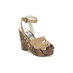 Sandały MICHAEL Michael Kors  MEGAN. Czarne sandały damskie marki MICHAEL Michael Kors, z gumy, przed kolano, na wysokim obcasie. Za 769,00 zł.