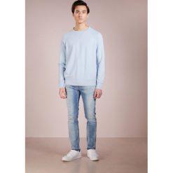 7 for all mankind RONNIE UNROLLED Jeansy Slim Fit hellblau washed. Niebieskie jeansy męskie regular 7 for all mankind, z bawełny. W wyprzedaży za 472,05 zł.