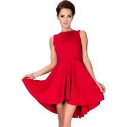 Elvira Ekskluzywna sukienka z dłuższym tyłem - czerwona. Różowe sukienki z falbanami marki numoco, l, z długim rękawem, maxi, oversize. Za 149,99 zł.