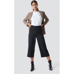 NA-KD Szerokie spodnie - Black. Niebieskie spodnie z wysokim stanem marki NA-KD, z satyny. Za 121,95 zł.