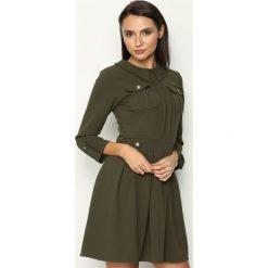 Ciemnozielona Sukienka Restrict. Zielone sukienki mini marki Reserved, z wiskozy. Za 89,99 zł.