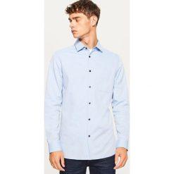 Koszula slim fit - Niebieski. Niebieskie koszule męskie slim marki Reserved, m. Za 99,99 zł.