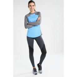 Under Armour REACTOR Koszulka sportowa mako blue light heather. Niebieskie topy sportowe damskie marki Under Armour, l, z elastanu. W wyprzedaży za 215,20 zł.