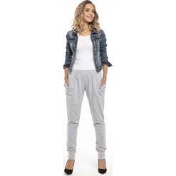Sportowe Jasnoszare Spodnie ze Ściągaczami. Szare bryczesy damskie marki New Balance, xs, z dresówki. Za 129,90 zł.