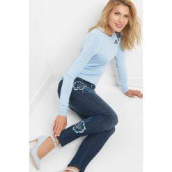 Jeansy skinny z haftem. Czarne jeansy damskie marki Orsay, xs, z bawełny, z dekoltem na plecach. W wyprzedaży za 110,00 zł.