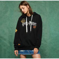 Bluza z naszywkami Harry Potter - Czarny. Czarne bluzy damskie Sinsay, l, z aplikacjami. Za 79,99 zł.