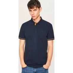 Koszulka polo - Granatowy. Niebieskie koszulki polo Reserved, l. Za 79,99 zł.