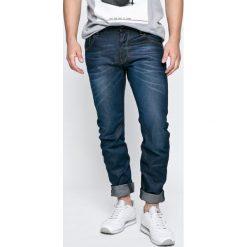 G-Star Raw - Jeansy . Niebieskie jeansy męskie slim marki G-Star RAW. W wyprzedaży za 449,90 zł.