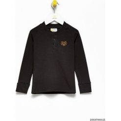 Bluzka dziecięca Black Polo Shirt. Białe t-shirty chłopięce z długim rękawem marki UP ALL NIGHT, z bawełny. Za 69,00 zł.