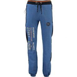 """Spodnie dresowe """"Mindwiller"""" w kolorze niebieskim. Niebieskie spodnie dresowe męskie Geographical Norway, z aplikacjami, z dresówki. W wyprzedaży za 117,95 zł."""