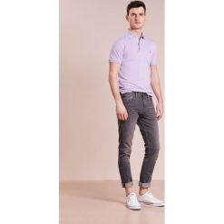 Polo Ralph Lauren Koszulka polo powder purple. Fioletowe koszulki polo marki Polo Ralph Lauren, m, z bawełny. W wyprzedaży za 344,25 zł.