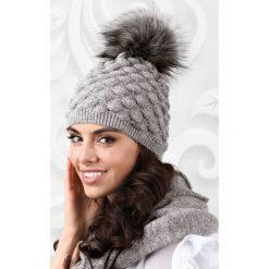 Damska czapka Sassari. Żółte czapki zimowe damskie Astratex, na zimę, z dzianiny. Za 66,99 zł.
