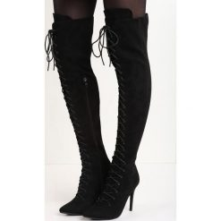 Czarne Kozaki Lorcan. Czarne buty zimowe damskie marki Born2be, ze szpiczastym noskiem, na wysokim obcasie, na obcasie. Za 104,99 zł.