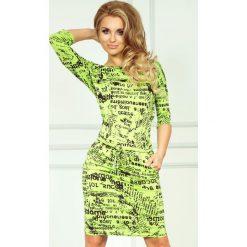 Cher Sukienka sportowa - gazetowe napisy + zielony. Zielone sukienki sportowe numoco, na imprezę, z napisami, z wiskozy, sportowe. Za 109,00 zł.