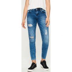 Rurki damskie: Jeansy skinny z przetarciami - Granatowy