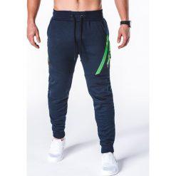SPODNIE MĘSKIE DRESOWE P660 - GRANATOWE. Niebieskie spodnie dresowe męskie marki Ombre Clothing, z bawełny. Za 69,00 zł.