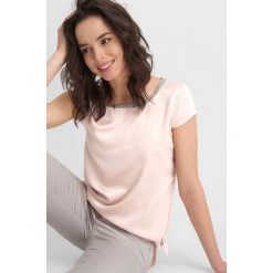 Odzież sportowa damska: Koszulka z wiązaniem
